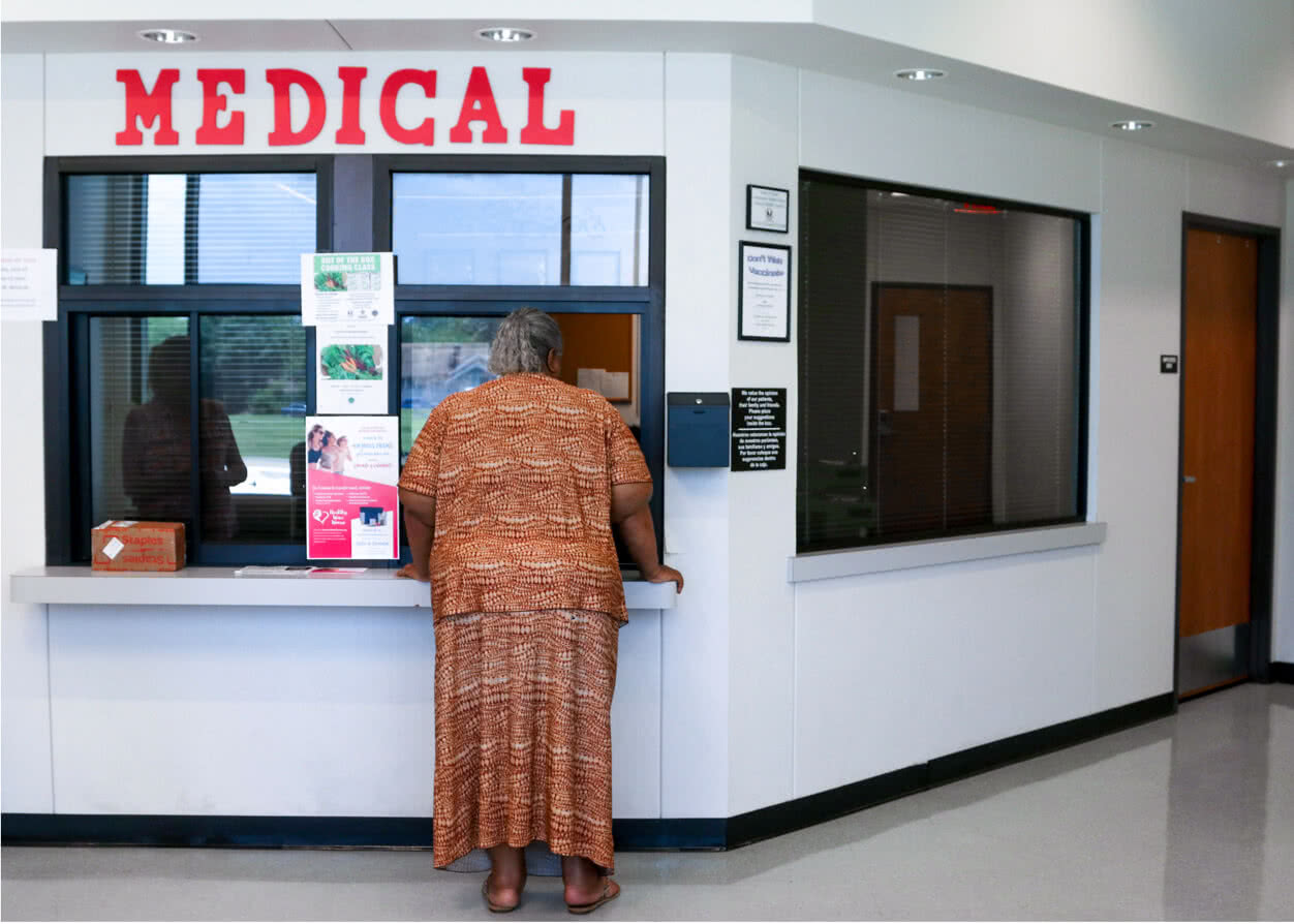 Patient checking in at medical counter.